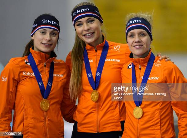 Femke Kok Jutta Leerdam and Letitia De Jung of the Netherlands pose for a picture after winning the ladies team sprint during the ISU World Single...