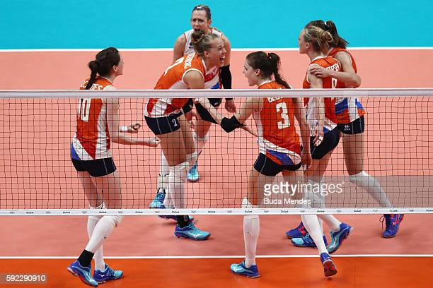 Femke Stoltenborg Yvon Belien Lonneke Sloetjes of Netherlands celebrate winning the second set during the Women's Bronze Medal Match between...