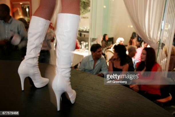 Femme Coiffure and Spa Holiday Party Dancer in Gogo Boots