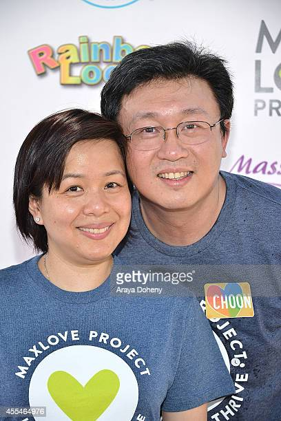 Fen Chan and Cheong Choon Ng attend the MaxLove LoomAThon 2 with Melissa Joan Hart on September 14 2014 in Tustin California