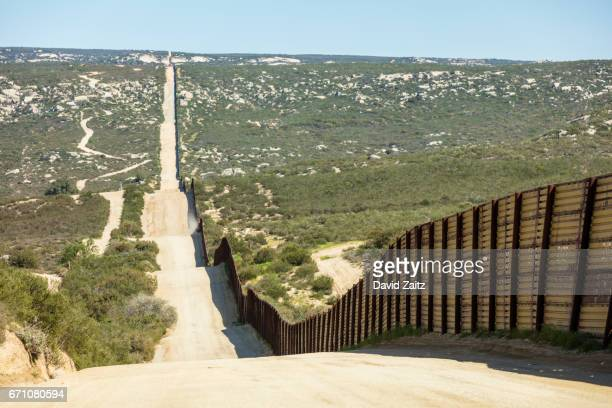 Fence along United States border with Mexico in California.