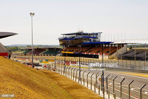 fence along with motor racing track, le mans, france - sarthe stock pictures, royalty-free photos & images