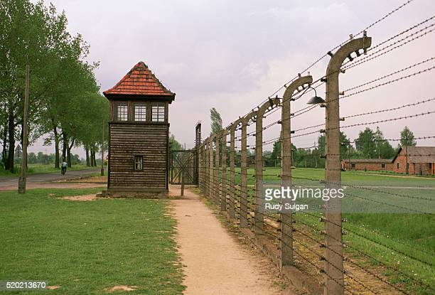 fence and guardhouse in auschwitz concentration camp - auschwitz concentration camp stock pictures, royalty-free photos & images