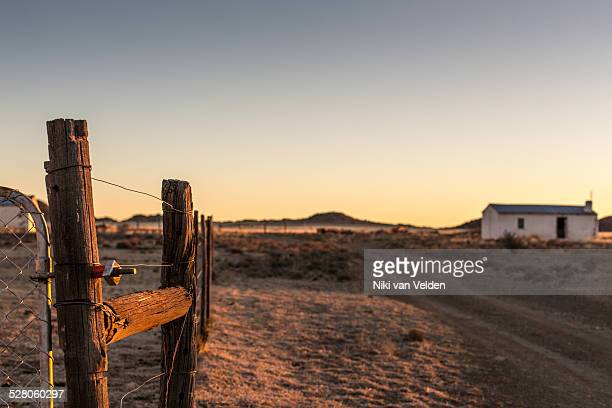 fence and house in karoo desert - the karoo stock photos and pictures