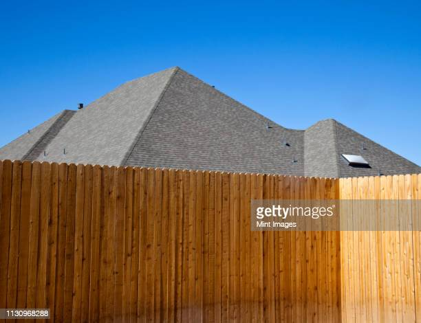 fence and roof - fence stock pictures, royalty-free photos & images