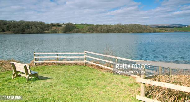 fence and seat - nigel owen stock pictures, royalty-free photos & images