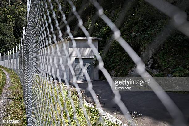 A fence guards the exterior entrance to the Swiss Data Safe AG formermilitary bunker secure storage facility in Amsteg Switzerland on Thursday Aug 5...