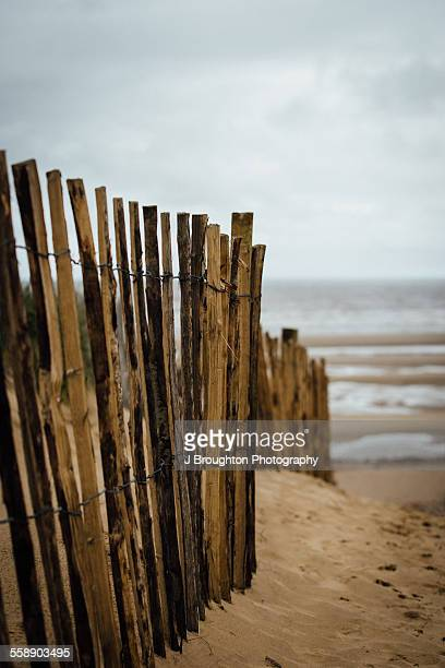Fence in sand