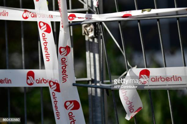 A fence is fixed with a tape labelled with the logo of German airline Air Berlin in Berlin on October 12 2017 Germany's biggest airline Lufthansa...