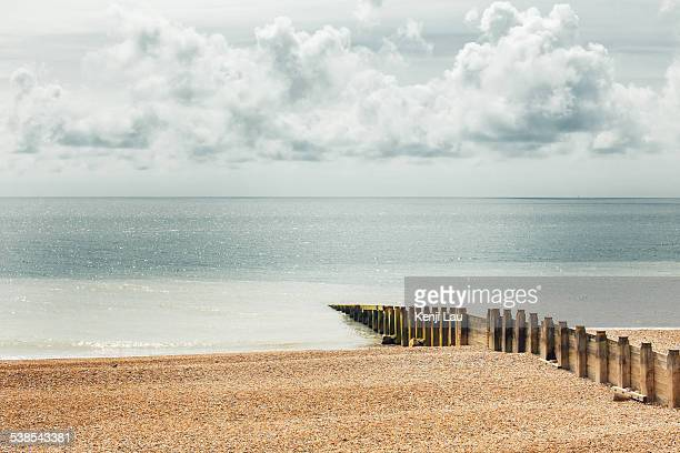 fence jutting out into the sea - non urban scene stock pictures, royalty-free photos & images