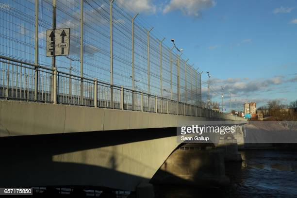A fence lines the bridge over the Narva River on the Estonian side as the bridge leads to Russia on March 23 2017 at Narva Estonia Estonia is a...