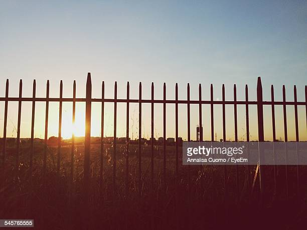 fence on field against clear sky during sunset - cuomo stock pictures, royalty-free photos & images