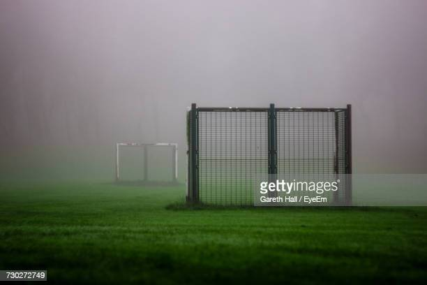 Fence On Field Against Sky During Foggy Weather