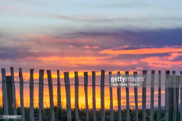 fence on landscape against romantic sky at sunset - heavens gate cult stock pictures, royalty-free photos & images