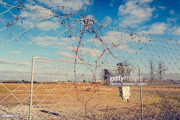 fence on landscape against sky - albrecht schlotter stock photos and pictures