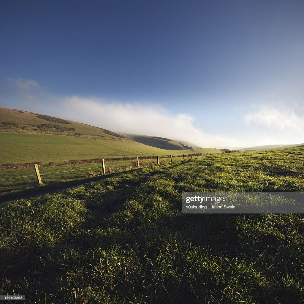 Fence on mounatin aginst sky : Stock Photo