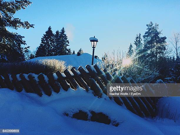 fence on snow covered field against sky - rachel wolfe stock pictures, royalty-free photos & images