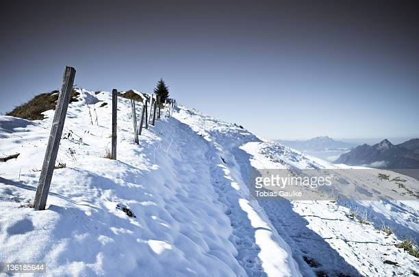 Fence on snowy landscape