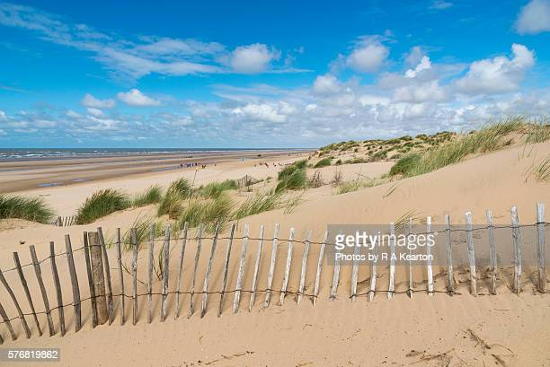 Fence on the dunes at Formby point, Merseyside