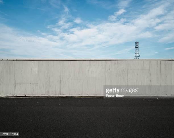 Fence, roadside and sky