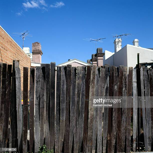 Fence, rooftops and antennas in Sydney, Australia