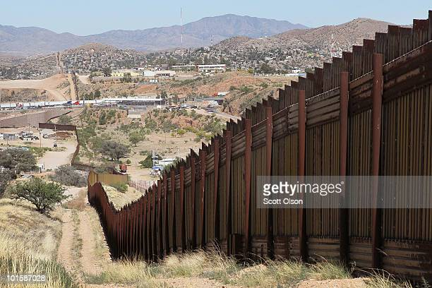 A fence separates the cities of Nogales Arizona and Nogales Sonora Mexico a frequent crossing point for people entering the United States illegally...