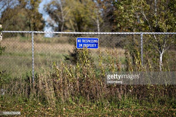 A fence stands at an entrance to a 3M Co disposal site in Oakdale Minnesota US on Thursday Oct 18 2018 3M's Cottage Grove factory had been churning...