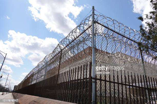 A fence surrounds the Cook County jail complex on April 09 2020 in Chicago Illinois With nearly 400 cases of COVID19 having been diagnosed among the...