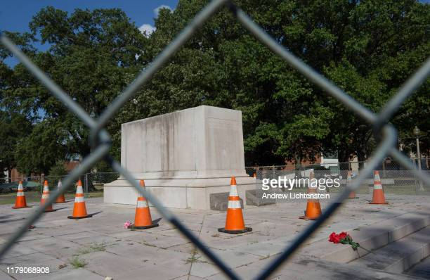 A fence surrounds the pedestal that used to hold a statue of Confederate General and Klu Klux Klan founder Nathan Bedford Forest before it was...