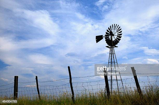 fence, windmill, sky - timothy hearsum stock pictures, royalty-free photos & images
