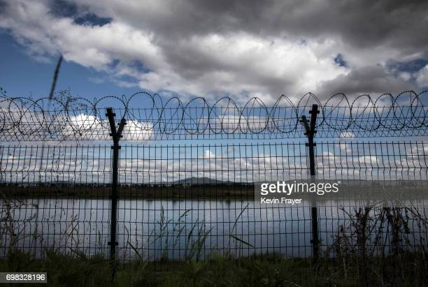 A fence with razor wire is seen protecting the border on the Yalu river north of the border city of Dandong Liaoning province northern China across...