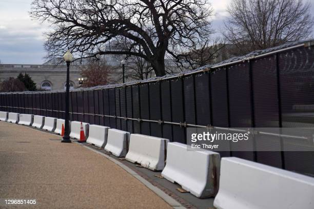 Fence with razor wire is seen west of the U.S. Capitol on January 17, 2021 in Washington, DC. After last week's riots at the U.S. Capitol Building,...