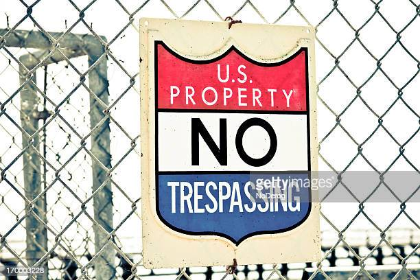 Fence with US Property No Trespassing sign
