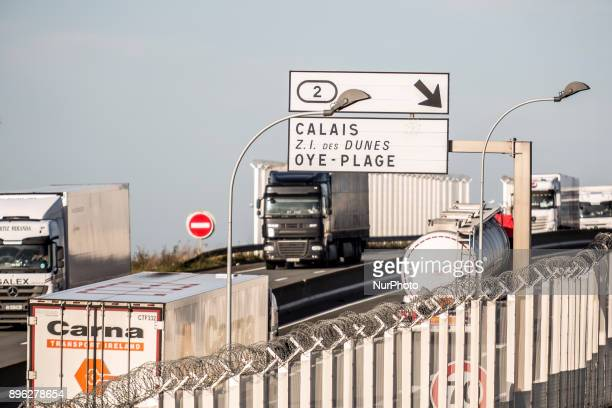 Fenced highway which leads directly to the border zone in Calais France on December 19 2017