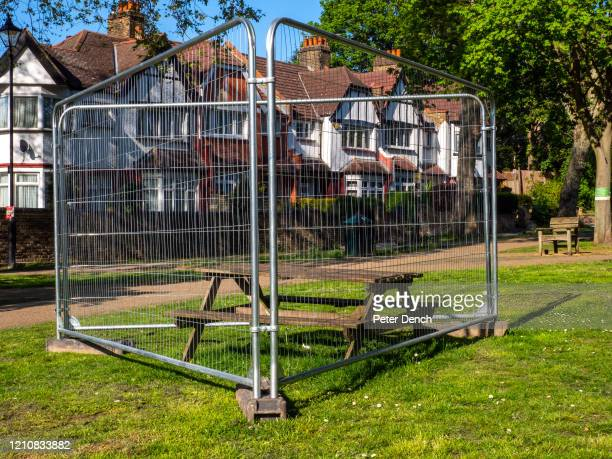 """Fenced off picnic table in a recreational space on April 22, 2020 in London, England. Taped-off benches and other """"social distancing"""" markers have..."""