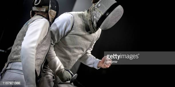 fencer athletes celebrating victory during the olympics - the olympic games stock pictures, royalty-free photos & images