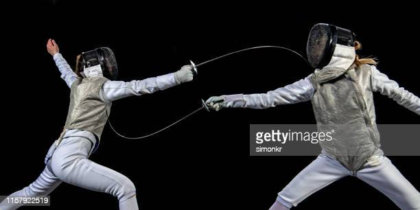 fencer athletes competing during a sporting event - face guard sport stock pictures, royalty-free photos & images