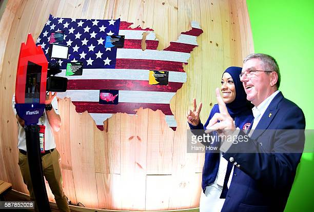 Fencer Ibtihaj Muhammad of the United States poses for a photo with International Olympic Committe President Thomas Bach in the Twitter room at the...