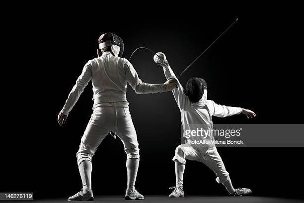 Fencers fencing