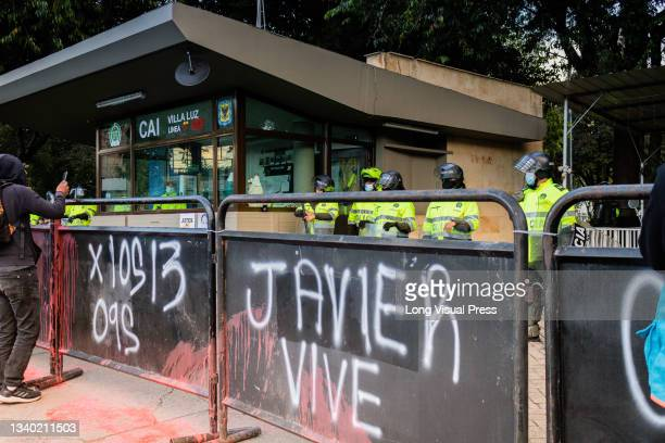 Fences that protect the Villa Luz CAI police station read 'For the 13 who died on September 9 and Javier lives' were police officers tortured Javier...