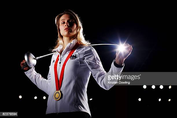 Fencing gold medalist Britta Heidemann poses with her medal during a portrait session at the fencing training hall on August 16, 2008 in Beijing,...
