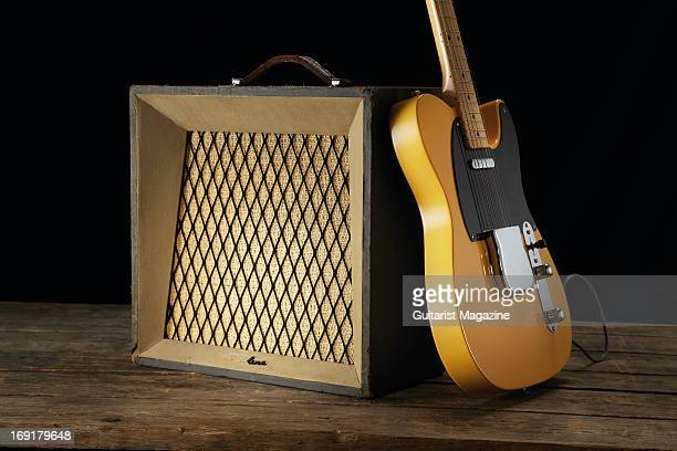 A Fender American Vintage '52 Telecaster electric guitar leaning on an Airline 3731 Montgomery Ward combo amp taken on October 16 2012