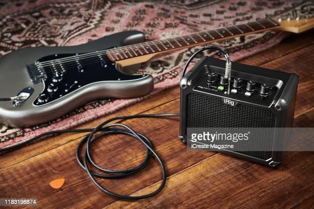 A Fender electric guitar alongside an IK Multimedia iRig Micro Amp taken on April 1 2018