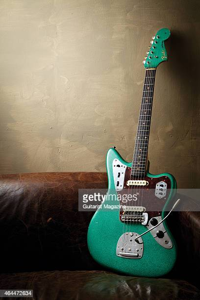 Fender Jaguar with a Green Sparkle finish photographed on a leather couch taken on January 17 2014