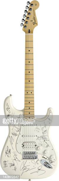 A Fender Standard Stratocaster electric guitar signed by the bands playing at Sonisphere Festival 2011 Studio shoot for Total Guitar Magazine August...
