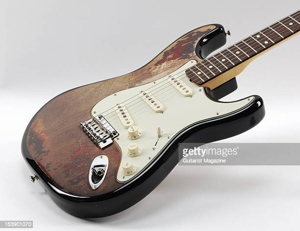 A Fender Stratocaster style electric guitar with a Rory Gallagher Facelift sticker applied to the guitar's front during a studio shoot for Guitarist...