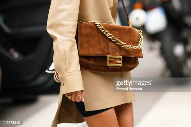 Fendi brown suede bag with a golden chain is seen outside the Fendi show during Milan Fashion Week Spring/Summer 2020 on September 19 2019 in Milan...