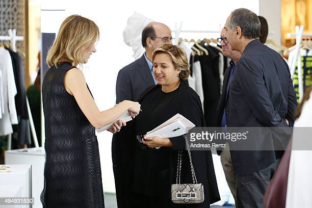 Fendi designer Silvia Venturini Fendi and Raffaello Napoleone visit the Designer Showcase during the Vogue Fashion Dubai Experience 2015 at The Dubai...