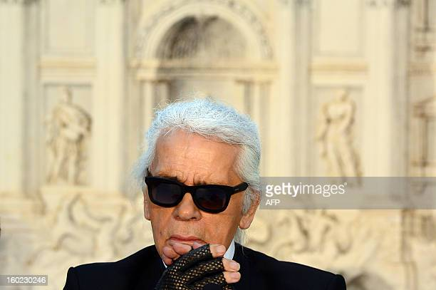 Fendi's designers Karl Lagerfeld reacts during a press conference announcing Fendi would finance a renovation of the Trevi Fountain in Rome on...