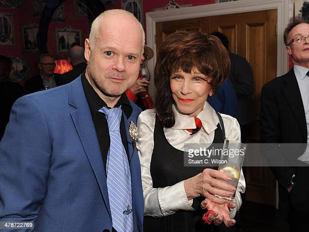 Fenella Fielding and Martin Firrell attend a private screening of metaFenella at Soho Hotel on March 14 2014 in London England